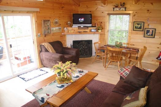 living room with fireplace at lazy rooster a 2 bedroom cabin rental located in gatlinburg