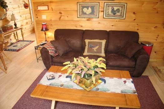 sofa bed in living room at lazy rooster a 2 bedroom cabin rental located in gatlinburg