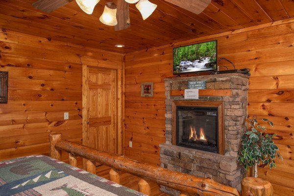 Fireplace and TV in a bedroom at 5 Star View, a 3 bedroom cabin rental located in Gatlinburg