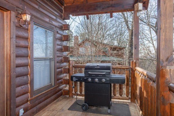 Propane grill on a covered deck at 5 Star View, a 3 bedroom cabin rental located in Gatlinburg