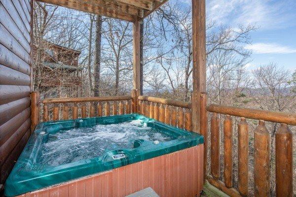 Hot tub on a covered deck at 5 Star View, a 3 bedroom cabin rental located in Gatlinburg