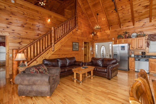 Sofa and two loveseats with kitchen nearby at 5 Star View, a 3 bedroom cabin rental located in Gatlinburg