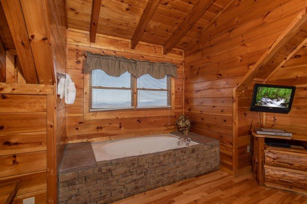 Jacuzzi tub in the loft bedroom at 5 Star View, a 3 bedroom cabin rental located in Gatlinburg