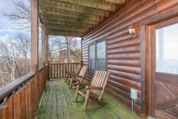 Covered deck with rocking chairs at 5 Star View, a 3 bedroom cabin rental located in Gatlinburg