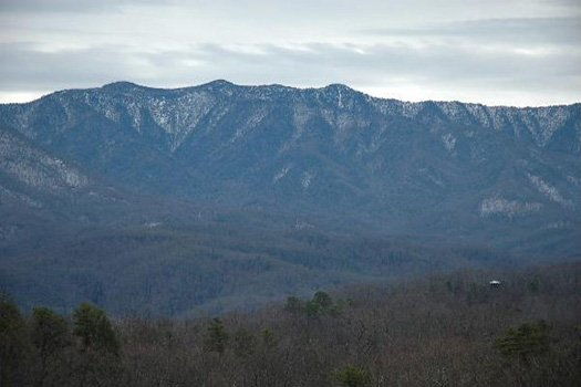 Snow capped mountain tops seen from 5 Star View, a 3 bedroom cabin rental located in Gatlinburg