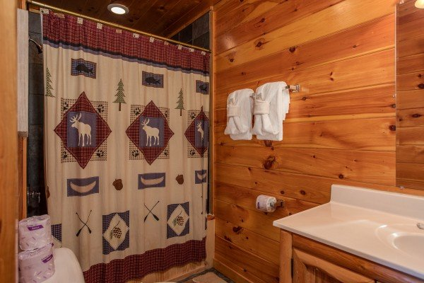 Bathroom with a tub and shower at 5 Star View, a 3 bedroom cabin rental located in Gatlinburg