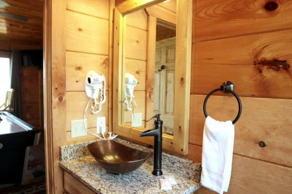 Custom sink in the half bath at Makin' Honey, a 1 bedroom cabin rental located in Pigeon Forge