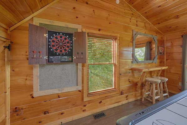 Electronic dart board in the game loft at Makin' Honey, a 1 bedroom cabin rental located in Pigeon Forge