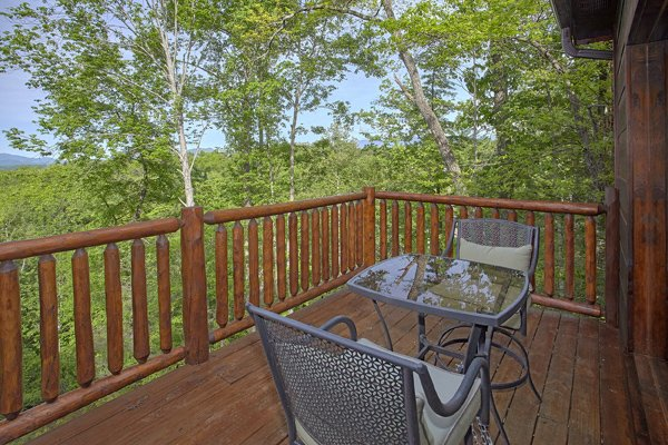 Deck dining for two at Makin' Honey, a 1 bedroom cabin rental located in Pigeon Forge