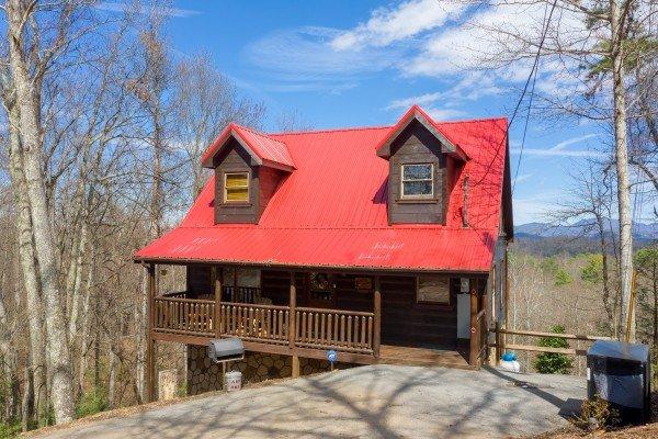 Front exterior of cabin with grill and trash cans at Makin' Honey, a 1 bedroom cabin rental located in Pigeon Forge