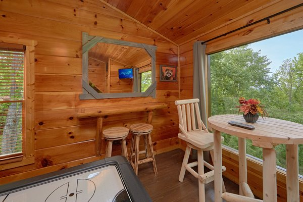 Seating in the game loft at Makin' Honey, a 1 bedroom cabin rental located in Pigeon Forge