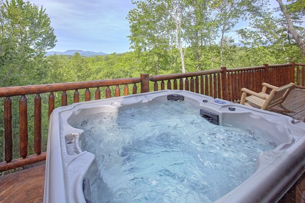 Hot tub overlooking the wooded mountain view at Makin' Honey, a 1 bedroom cabin rental located in Pigeon Forge