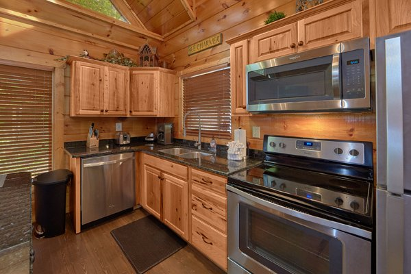 Kitchen with stainless appliances at Makin' Honey, a 1 bedroom cabin rental located in Pigeon Forge