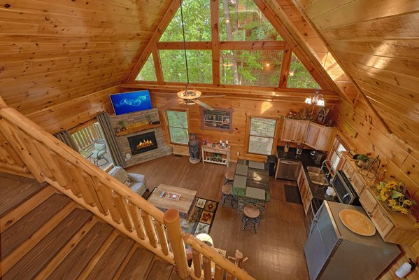 Looking down onto the open concept main floor at Makin' Honey, a 1 bedroom cabin rental located in Pigeon Forge