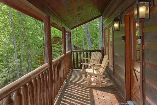 Covered porch with rocking chairs at Makin' Honey, a 1 bedroom cabin rental located in Pigeon Forge
