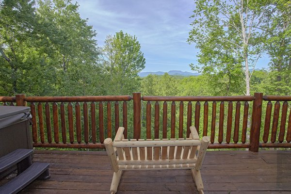 Oversized rocker looking at the mountains at Makin' Honey, a 1 bedroom cabin rental located in Pigeon Forge