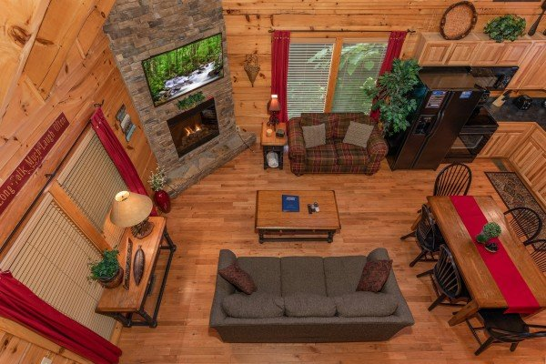 Looking down into the living room at Little Chateau, a 1 bedroom cabin rental located in Pigeon Forge