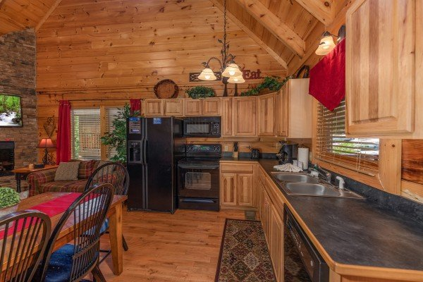 Kitchen with black appliances at Little Chateau, a 1 bedroom cabin rental located in Pigeon Forge