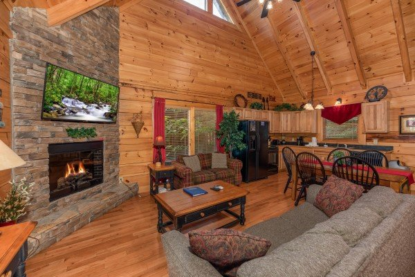 Open concept living, dining, and kitchen at Little Chateau, a 1 bedroom cabin rental located in Pigeon Forge