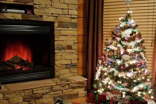 Christmas tree and fireplace at Azalea Point, a 2 bedroom cabin rental located in Pigeon Forge