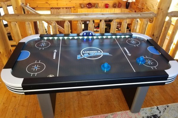 Air hockey at Azalea Point, a 2 bedroom cabin rental located in Pigeon Forge