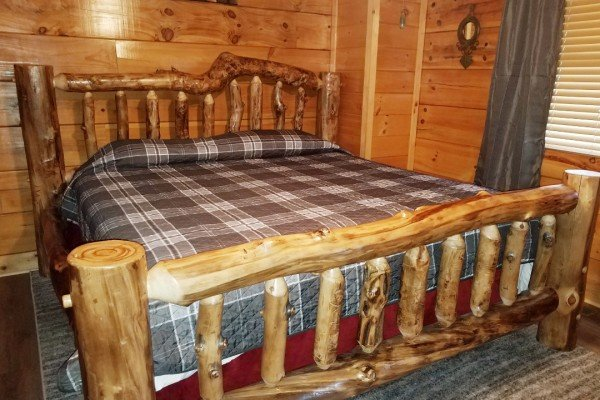Log bed at Azalea Point, a 2 bedroom cabin rental located in Pigeon Forge
