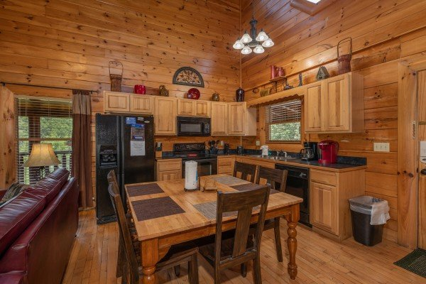Dining table for six at Azalea Point, a 2 bedroom cabin rental located in Pigeon Forge