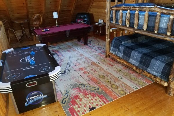 Game loft and bunk beds at Azalea Point, a 2 bedroom cabin rental located in Pigeon Forge