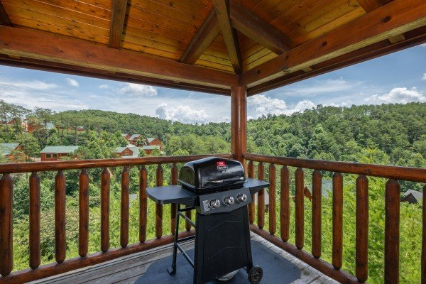 Propane grill on a covered deck at Azalea Point, a 2 bedroom cabin rental located in Pigeon Forge