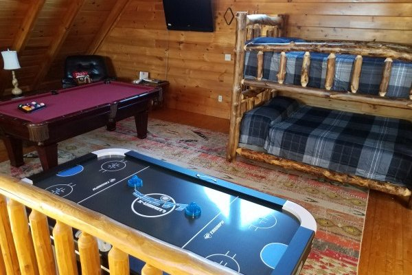 Loft with bunk beds, pool, and air hockey at Azalea Point, a 2 bedroom cabin rental located in Pigeon Forge