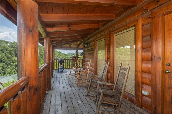 Rocking chairs on a covered porch at Azalea Point, a 2 bedroom cabin rental located in Pigeon Forge