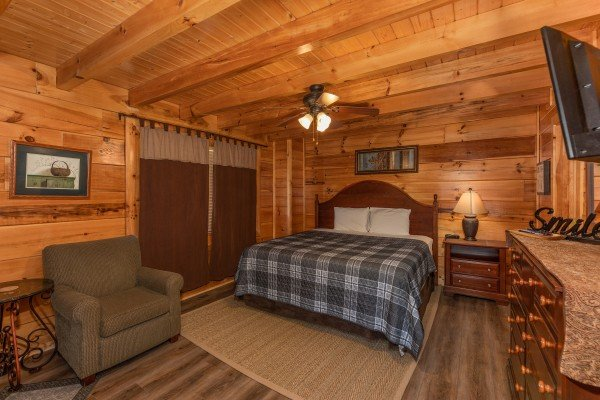 Bedroom with a queen bed, dresser, night stand, and chair at Azalea Point, a 2 bedroom cabin rental located in Pigeon Forge
