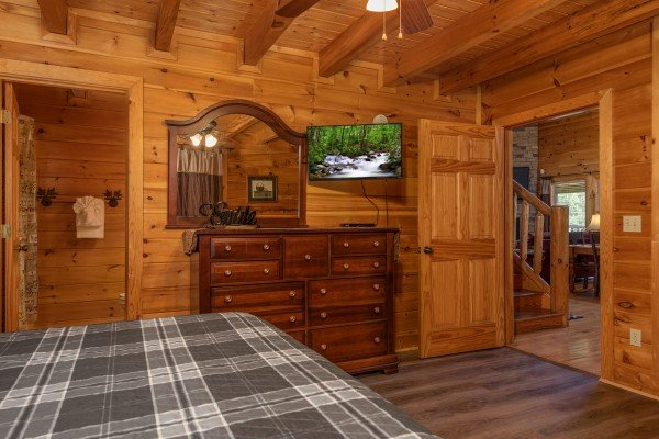 Dresser, mirror, and TV in a bedroom at Azalea Point, a 2 bedroom cabin rental located in Pigeon Forge