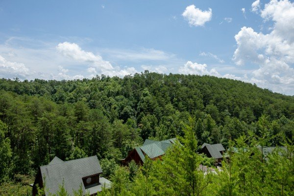 View of the hillside and cabin roofs at Azalea Point, a 2 bedroom cabin rental located in Pigeon Forge