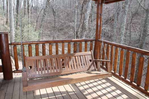 swing on deck of main level at bear bottom a 1 bedroom cabin rental located in gatlinburg