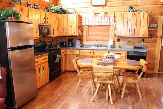 dining table for four near the kitchen at bear bottom a 1 bedroom cabin rental located in gatlinburg