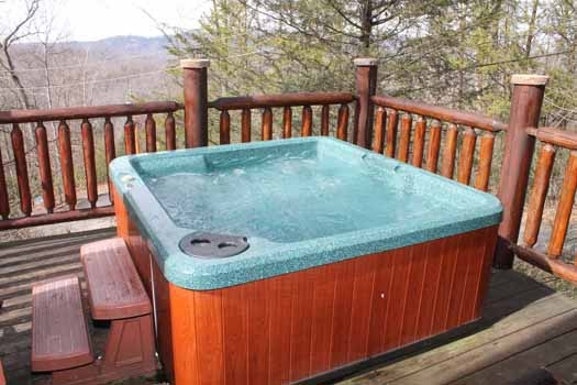 hot tube on second floor deck at bear bottom a 1 bedroom cabin rental located in gatlinburg