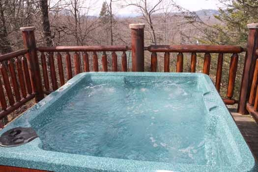 hot tub with a view from the second floor deck at bear bottom a 1 bedroom cabin rental located in gatlinburg