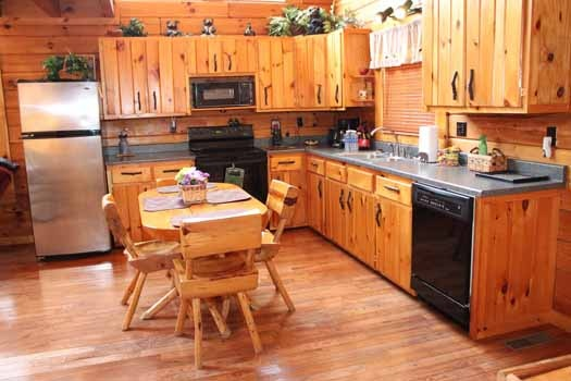 kitchen with table for four at bear bottom a 1 bedroom cabin rental located in gatlinburg