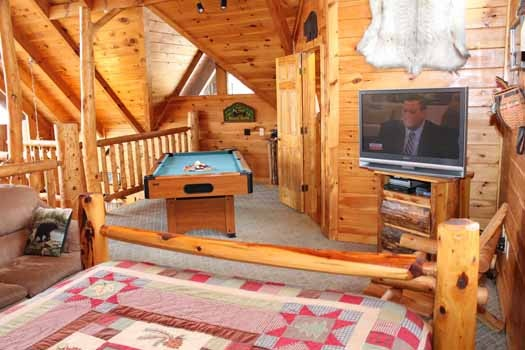 view of the pool table in loft from bed at bear bottom a 1 bedroom cabin rental located in gatlinburg