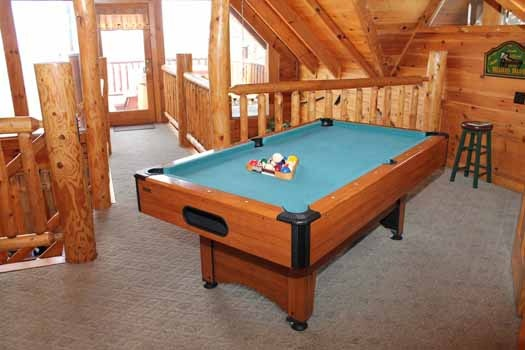 green felted pool table in the game room at bear bottom a 1 bedroom cabin rental located in gatlinburg