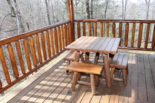 picnic table on deck at bear bottom a 1 bedroom cabin rental located in gatlinburg
