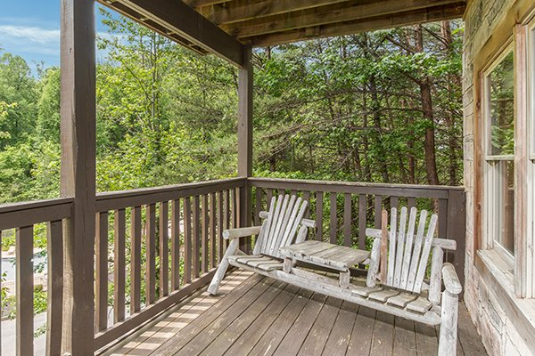 adirondak chairs with drink table at amazing journey a 5 bedroom cabin rental located in pigeon forge