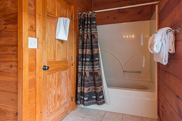 bathroom with a tub and shower at amazing journey a 5 bedroom cabin rental located in pigeon forge