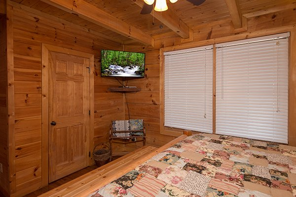 wall mounted television in a bedroom at amazing journey a 5 bedroom cabin rental located in pigeon forge