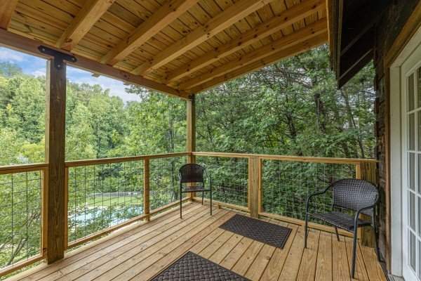 deck with two chairs at amazing journey a 5 bedroom cabin rental located in pigeon forge
