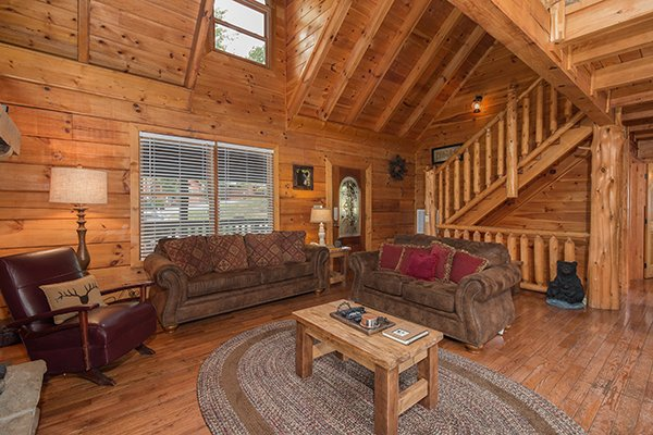 couches and glider in the living room at amazing journey a 5 bedroom cabin rental located in pigeon forge