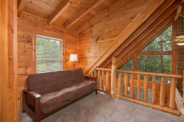 futon in the loft area at amazing journey a 5 bedroom cabin rental located in pigeon forge