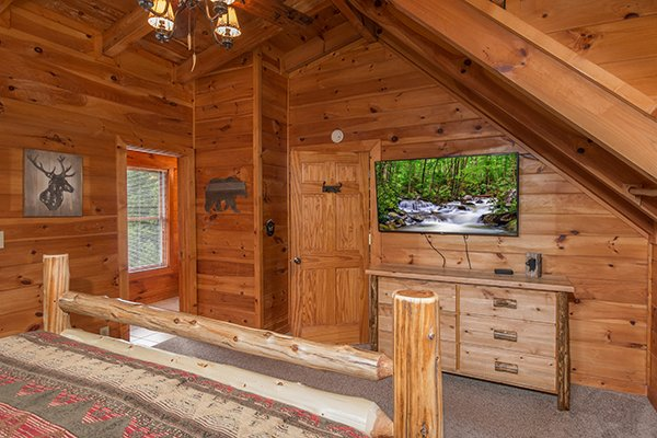 television and bedroom storage in the loft room at amazing journey a 5 bedroom cabin rental located in pigeon forge