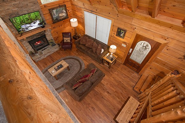overhead view of the living room and stone fireplace at amazing journey a 5 bedroom cabin rental located in pigeon forge